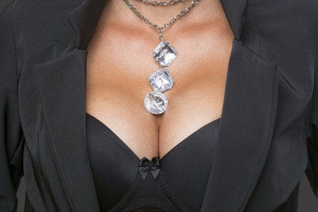 Big Breasts Lady In Sexy Corset and necklace jewelry photo