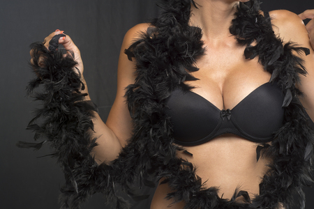 Big Breasts Lady In Sexy Corset Underwear and black feathers photo