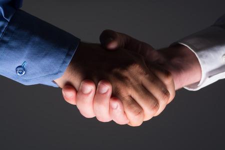 good bey: Two Businessman Handshake Handshaking between darkness and light
