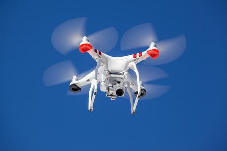 Drone flying on clear day, blue sky Standard-Bild - 119387665