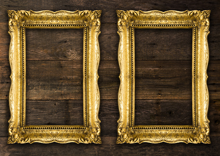 Two Old Picture Rustic Frames on wooden wall Standard-Bild - 119387977