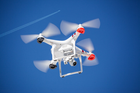 Can the dron endanger the plane? Drone and airplane are together on sky with big distance Standard-Bild - 119387982
