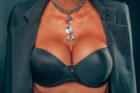 Big Tanned Breasts Lady In Sexy Corset and necklace jewelry Stok Fotoğraf