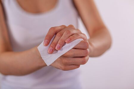 Close up scene woman cleaning hands with wet wipes, white Stock Photo