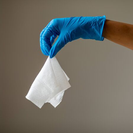 Wet Wipes Should be Thrown in the Trash - not in the sawer. Hand in blue protective glove