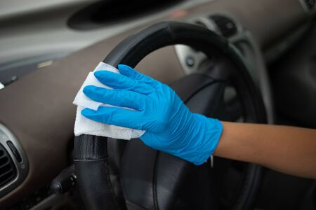Cleaning car enterier wit antibacterial wet wipes Archivio Fotografico