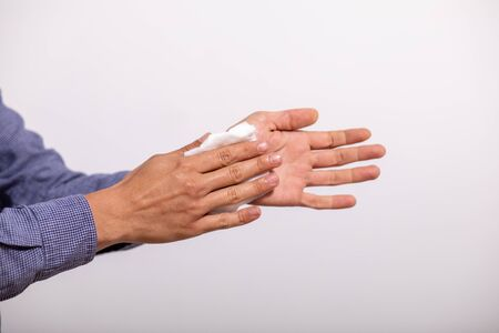 Young man cleaning hands with wet wipes Standard-Bild