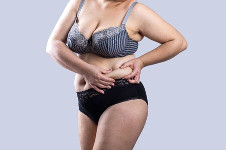 Woman Real Body Plus size Model in lingerie showing fat on stomach, imperfect nonideal