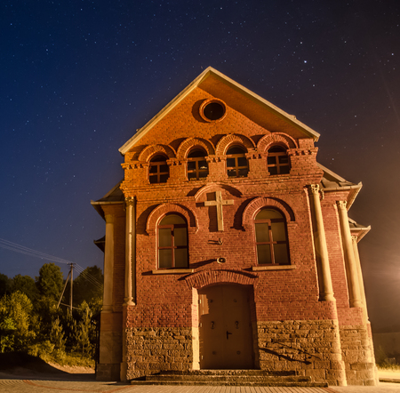 church with background of night sky and stars photo
