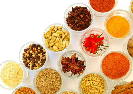 bowls of various ground and whole spice in rows