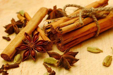 cinnamon , cardamom,cloves and star anise on a wooden board