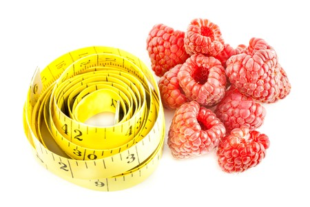 burette: Measure with raspberry on a white background