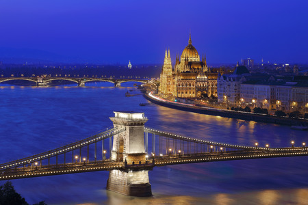 the chain bridge: The illuminated Chain Bridge and Parliament building in Budapest, Hungary.
