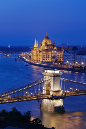 building a chain: The illuminated Chain Bridge and Parliament building in Budapest, Hungary.