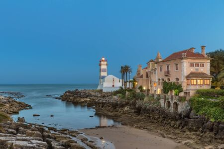marta: Santa Marta Lighthouse in the evening in Cascais, Portugal Stock Photo