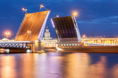 The raised Palace bridge at white nights in the city of St.-Petersburg Editorial
