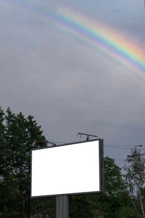 highroad: road billboard against the sky with a beautiful rainbow Stock Photo