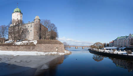 beautiful panorama of a city fortress Vyborg in sunny spring day Editorial