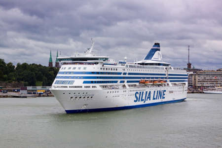 inhabitants: Helsinki, Finland-July 22 2013 : the SILJA LINE ferry sails from Helsinki port. Ferries of the Silja Line company enjoy wide popularity at inhabitants of the Baltic States also transport daily a great number of passengers Editorial