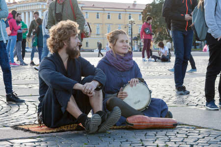 voices: St. Petersburg, Russia-September 09,2016: The street musician plays on the street of St. Petersburg. In St. Petersburg on streets it is often possible to meet the musicians entertaining people the music Editorial