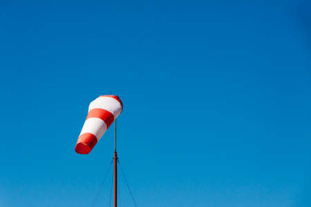 white sleeve: Airport windsock on clear blue sky background in clear day Stock Photo