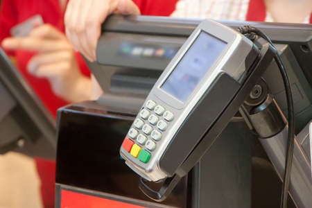 the terminal for payment by cash cards on cash desk in cafe Stock Photo
