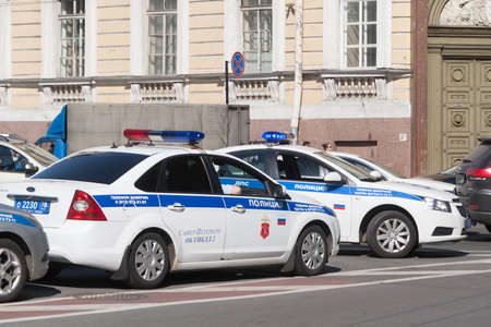 st: ST. PETERSBURG, RUSSIA - JUNE 18: Cars of traffic police patrol traffic in St. Petersburg,RUSSIA - JUNE 18 2017. In St. Petersburg on streets many police officers are on duty