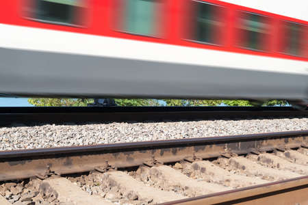 freight train: cars of the train moving on rails in clear summer day Stock Photo