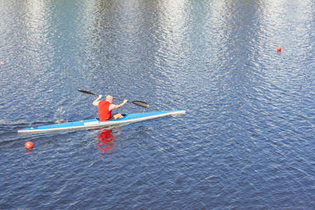 ST. PETERSBURG, RUSSIA - MAY 12 2018: the athlete trains on kayak. In Russia, many people are engaged in rowing