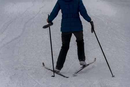 the person skis in a pack ice in winter day