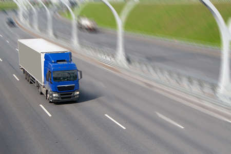 the truck goes on the highway in summer day