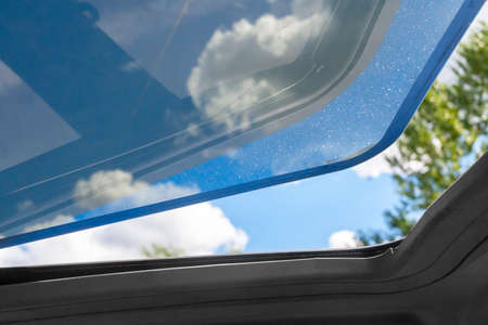 the open hatch in a car roof in hot summer clear day