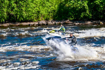 Losevo, RUSSIA-Jule 02, 2017:A man rides a water scooter along the Vuoks River. Water sports are popular in Russia.