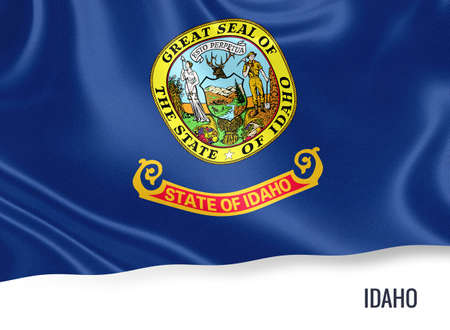U.S. state Idaho flag waving on an isolated white. State name included below the artwork. Stock Photo