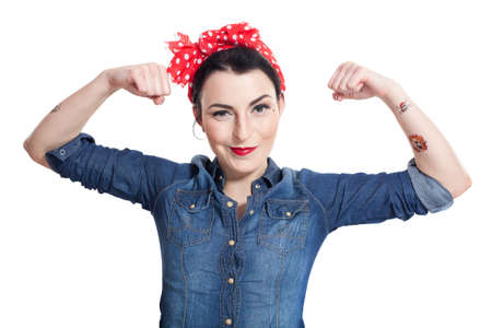 Woman in denim shirt with red kerchief holding hand in the air photo