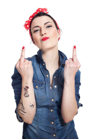 finger on lips: Woman in denim shirt with red kerchief showing middle fingers Stock Photo