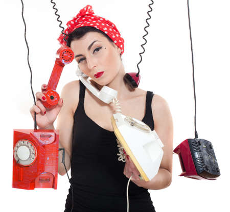 Woman with red kerchief holding many phones which are hanging photo
