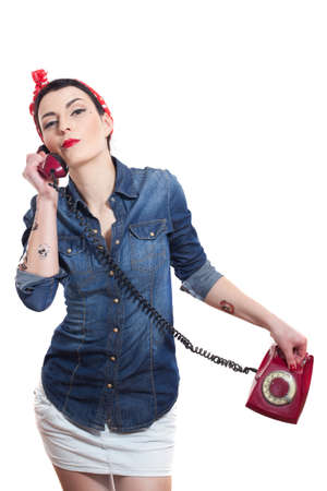 Woman with red kerchief holding a phone photo