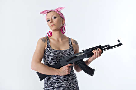 Dangerous young woman holding automatic rifle Stock Photo - 16717892