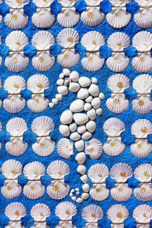 wll: Wll decoration - sea horse made of shells Stock Photo
