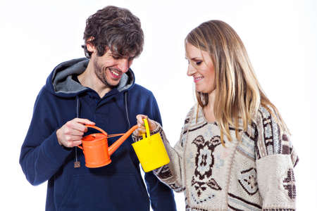 wateringcan: Happy couple playing with watering-can