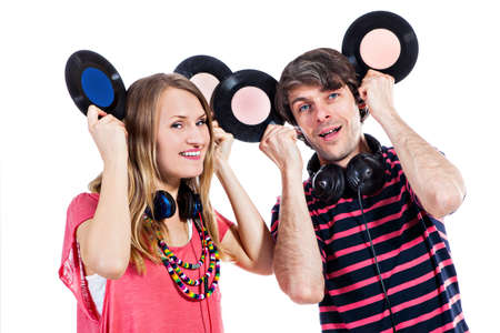 mickey: Happy young couple playing around with vinyl records isolated on a white background Stock Photo