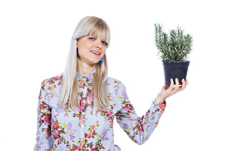 Beautiful blond girl holding fragrant potherb isolated on white background Stock Photo - 17642159