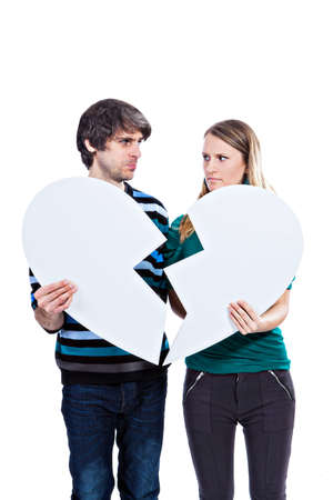 Young couple having love problems isolated on a white background photo