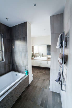 bathroom mirror: Inside of a modern bathroom with sink