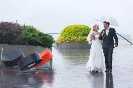 Rain pours on a wedding day Stock Photo