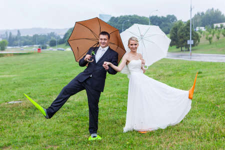 flippers: Couple wear flippers on a rainy wedding day