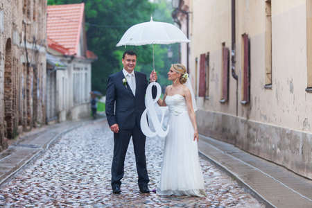 Rain pours on a wedding day photo