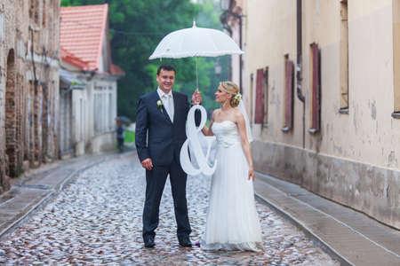 Rain pours on a wedding day Stock Photo - 22418810