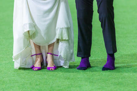 shoeless: Wedding couple in soccer field on their wedding day
